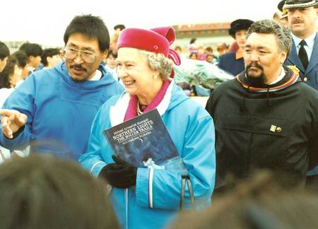 The Queen holding Michaels Northen Lights book